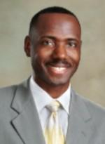 Dr. Carl E. Livingston